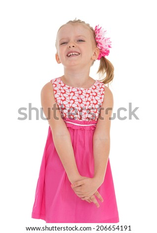 Smiling blonde girl in a pink dress.happy childhood, carefree childhood concept. - stock photo