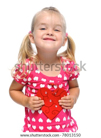 smiling blonde girl with valentine heart is isolated in studio