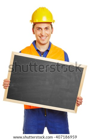 Smiling blue collar worker holding an empty blackboard - stock photo