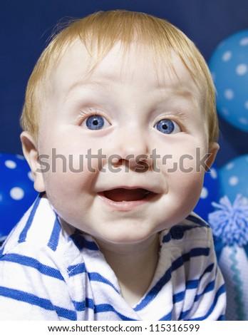 Smiling blue eyed infant - stock photo
