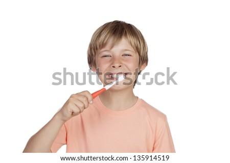 Smiling boy brushing his teeth isolated on white background - stock photo