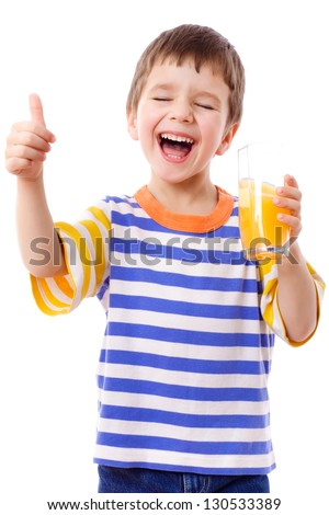 Smiling boy enjoying with glass of yellow juice, isolated on white - stock photo