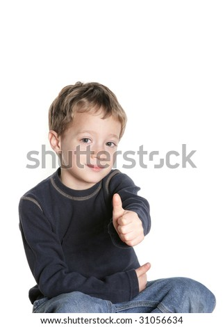 Smiling boy giving thumbs up sign