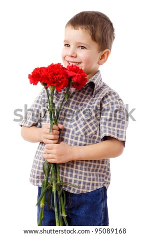 Smiling boy holding a bouquet of red carnations, isolated on white - stock photo