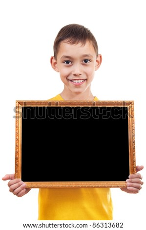smiling boy holding empty wooden frame with black copy-space isolated on white - stock photo