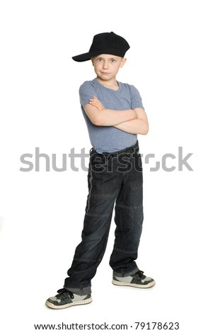 Smiling boy in a black baseball cap. Isolated on white.