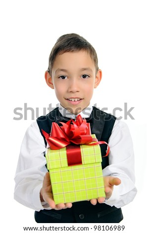 smiling boy in black suit holding green gift box with red bow isolated on white background - stock photo