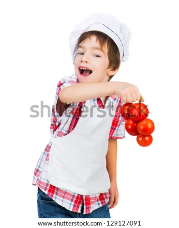 Smiling boy in dress Food Boy with tomatoes on white background - stock photo