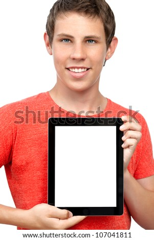 smiling boy in red t-shirt holding a with an insulated screen tablet touch pad computer gadget. - stock photo