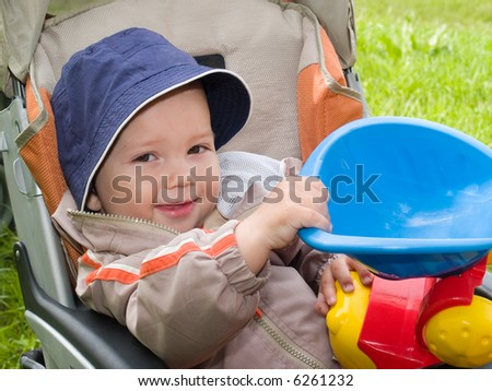 smiling boy in stroller