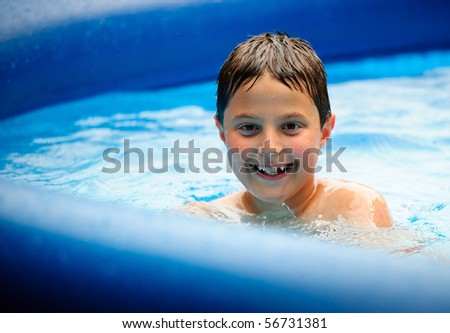 Smiling boy in the pool - stock photo
