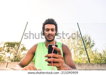 Smiling boy, listening music - stock photo