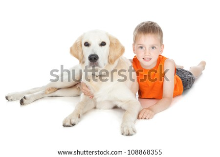 Smiling boy lying with his white dog over white - stock photo