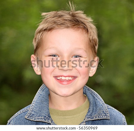 Smiling boy on a green background - stock photo