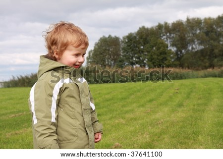 Smiling boy on the grassland