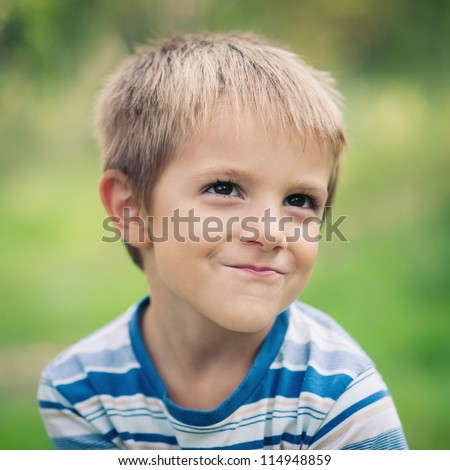 Smiling boy outdoors portrait. - stock photo