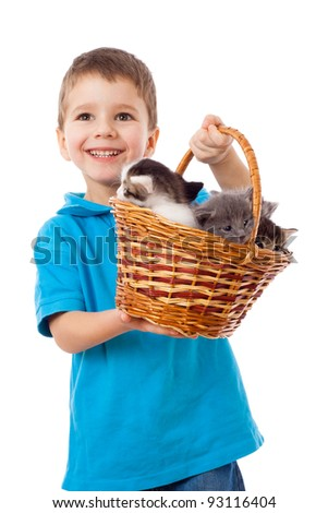Smiling boy picks up a basket with kittens, isolated on white