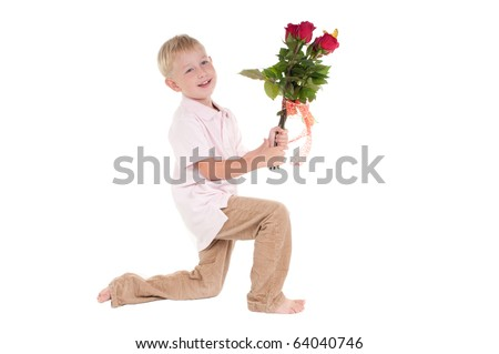 Smiling boy presenting  red roses - stock photo