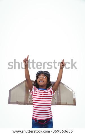 Smiling boy pretending to be pilot on white screen - stock photo