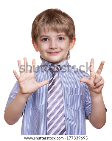 smiling boy shows eight fingers on a white background - stock photo