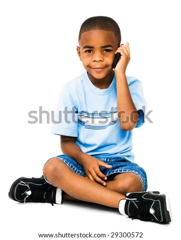 Smiling boy talking on a mobile phone isolated over white - stock photo