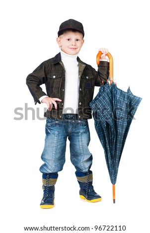 smiling boy wearing autumn clothes  with umbrella isolated on white background - stock photo