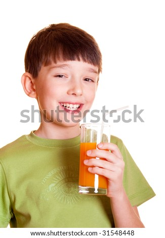 Smiling boy with a glass of juice - stock photo