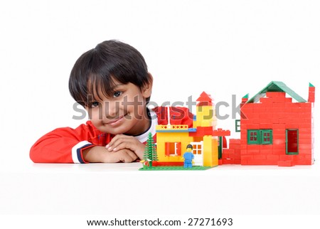 smiling boy with block houses - stock photo