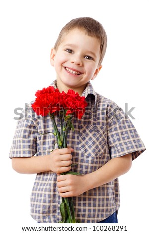 Smiling boy with bouquet of red carnations, isolated on white - stock photo