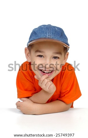smiling boy with denim cap, isolated on white - stock photo