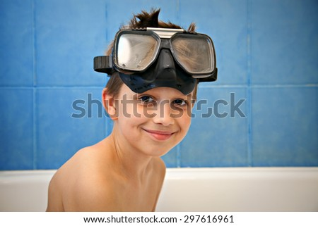 smiling boy with diving mask
