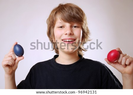 smiling boy with easter eggs