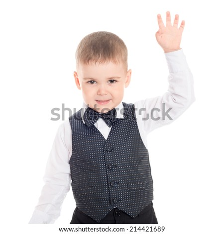 Smiling boy with his hand raised in greeting.