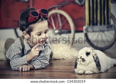 Smiling boy with rabbit - stock photo