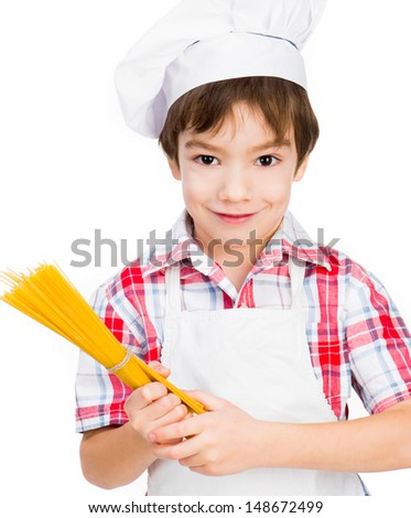 smiling boy with raw spaghetti isolated on a white background - stock photo