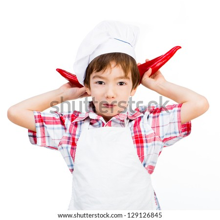 smiling boy with red peppers like ears - stock photo