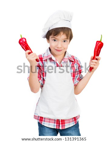smiling boy with red peppers on a white background - stock photo