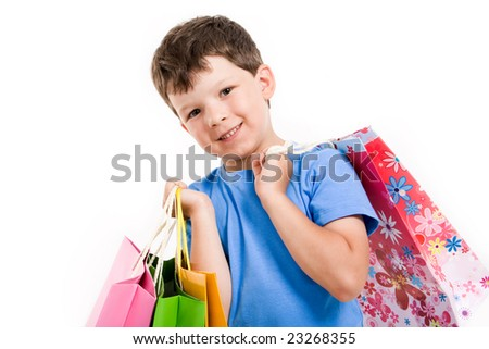 Smiling boy with shopping bags looking at camera wover white background - stock photo