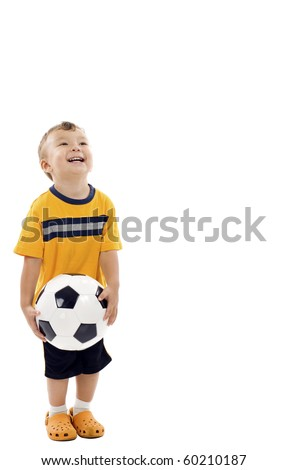 Smiling boy with soccer / football,  looking up at copyspace - isolated over white background - stock photo