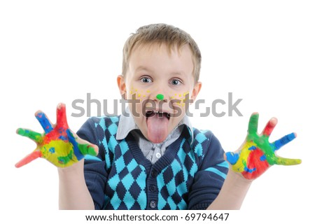 smiling boy with the palms painted by a paint. Isolated on white background - stock photo
