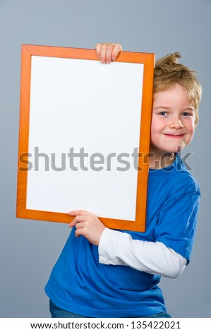 smiling boy with white tablet - stock photo