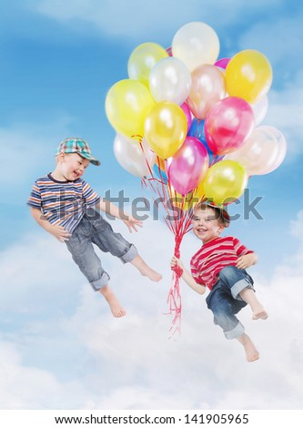 Smiling boys flying with balloons - stock photo
