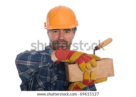 Smiling bricklayer with trowel and brick. - stock photo