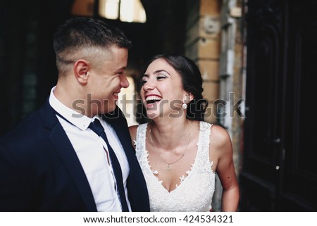 Smiling bride and groom - stock photo