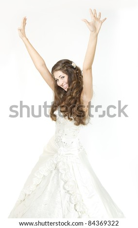 Smiling bride raised hands up and happy smiling. Over white.