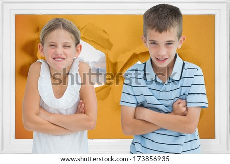 Smiling brother and sister posing together against bumpy road background - stock photo