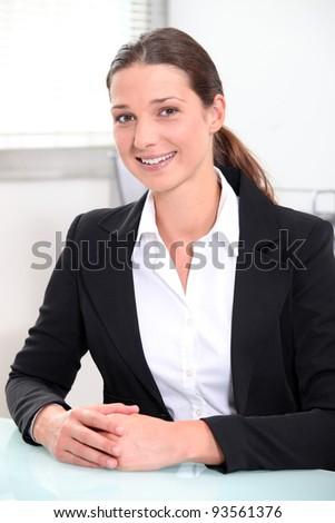 Smiling brunette businesswoman - stock photo
