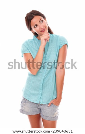 Smiling brunette female with hand on chin while looking to her left up and smiling in white background - copyspace - stock photo