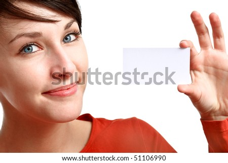 smiling brunette showing blank business card - stock photo