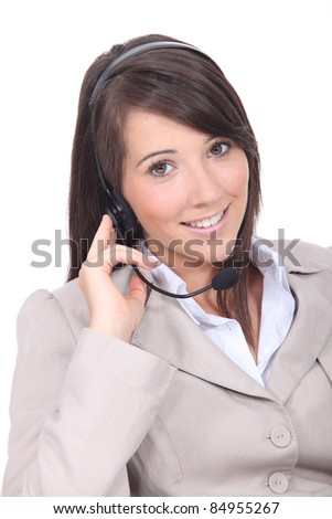 Smiling brunette wearing a headset - stock photo